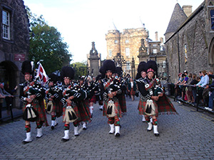 Clan Hay Pipe Band parading in Edinburgh's Royal Mile